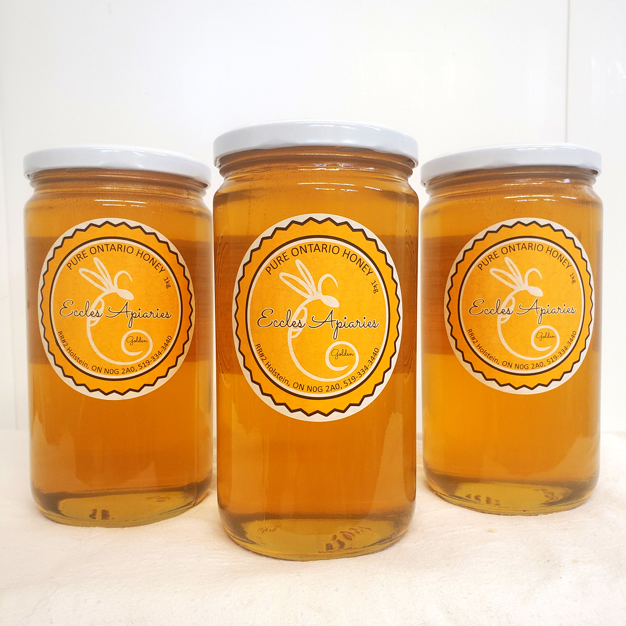 Three_Jars_of_Eccles_Apiaries_Honey